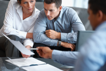 Real estate agent consulting a mature couple at office